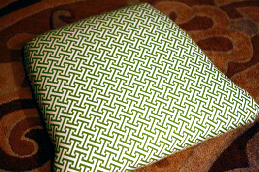 Green and white fabric upholstered seat on antique furniture