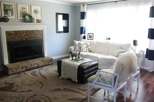 Living room: white sofas, navy and white striped curtains