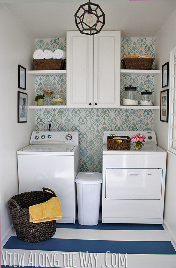 DIY laundry room update with stenciled walls and DIY painted vinyl floors