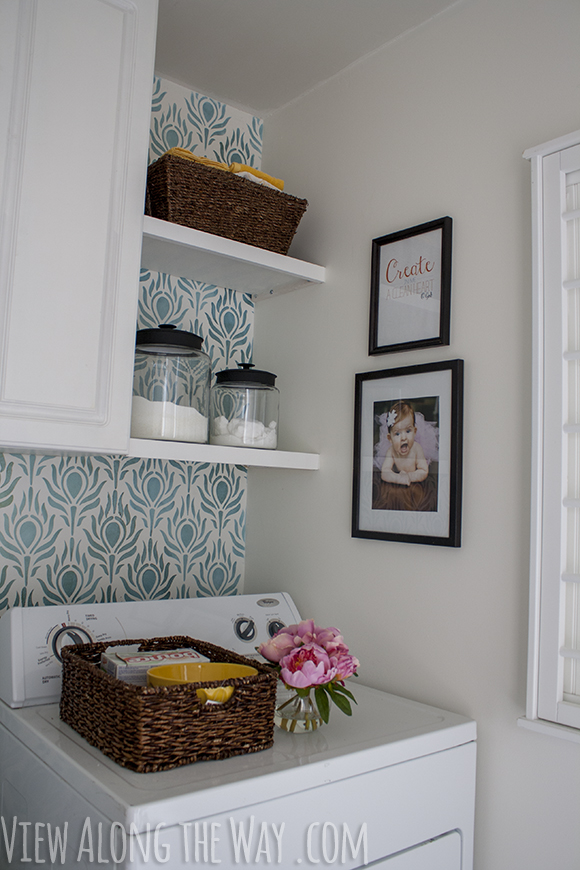 Updated DIY laundry room with free printable art and glass detergent storage