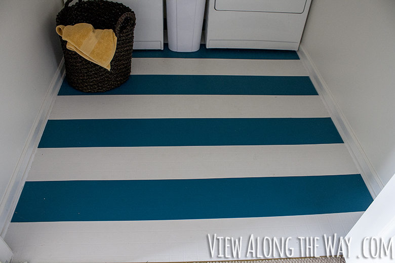 Painted striped vinyl floors, teal and white