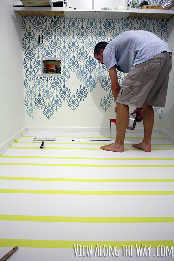 How to paint vinyl/laminate floors! It's easy and inexpensive! Click through for the full tutorial!