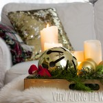 Decorate your coffee table for Christmas with candles and greenery on a tray!