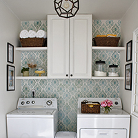 DIY laundry room with painted shelves and cabinet