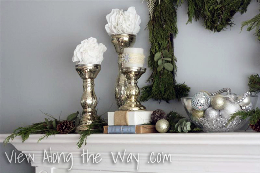 Silver Candlesticks with white candles and snowballs on a Christmas Mantle