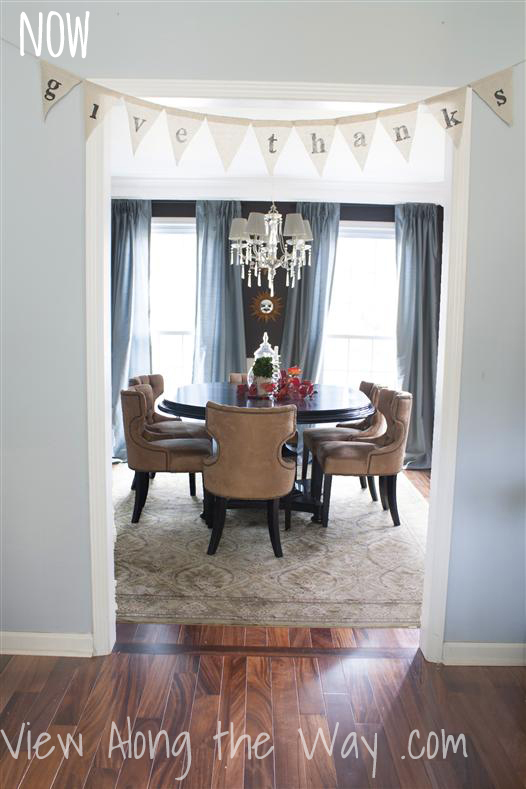 Dining Room: Dark brown walls, crystal chandelier, burlap banner