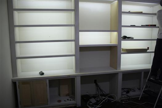 ... Bookshelves Lit With LED Reel/strip Lights