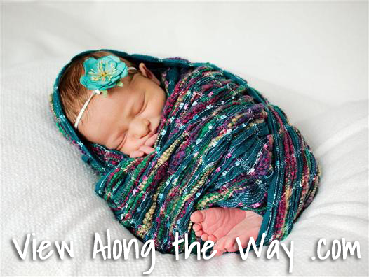 Professional baby photo in turquoise scarf
