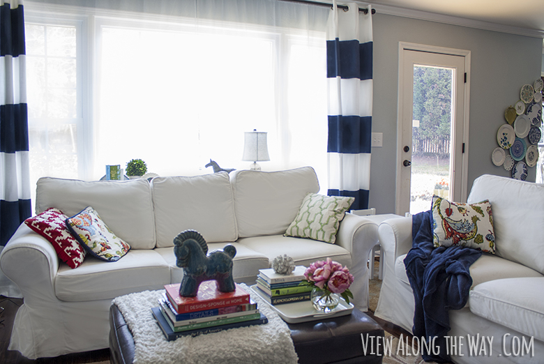 Living room: white ikea sofas, hollywood regency accessories