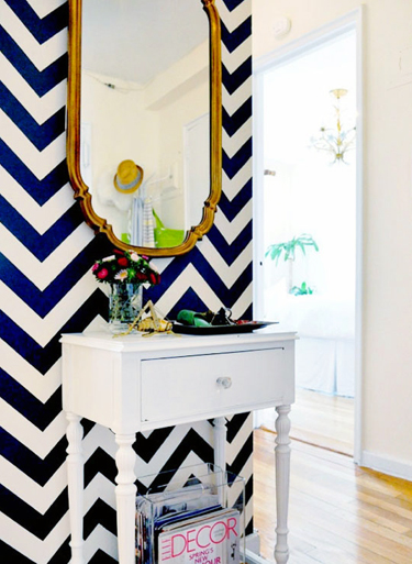 Wall stenciled with navy and white chevron stripes