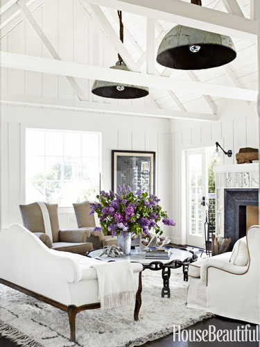 neutral family room with hanging buoy lights