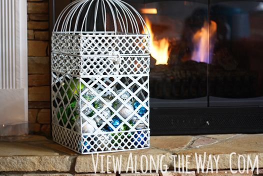 Use a birdcage to display christmas ornaments