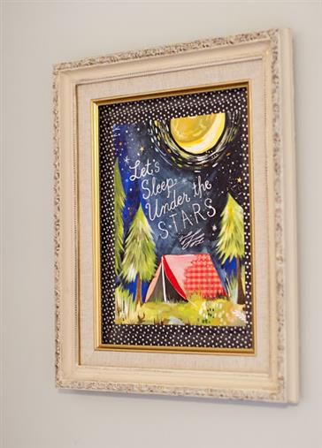 Tape a print to the wall with washi tape and frame it with a thrift store frame