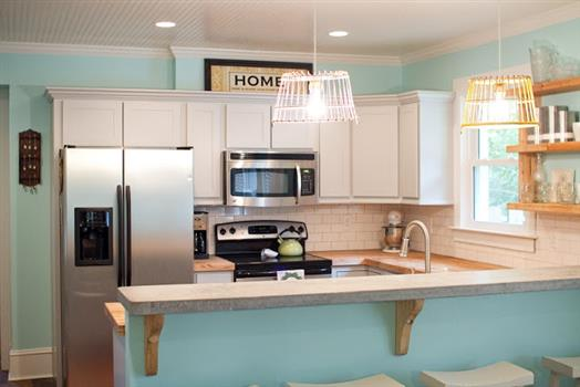 """Tame teal"" DIY kitchen with lots of pretty details"