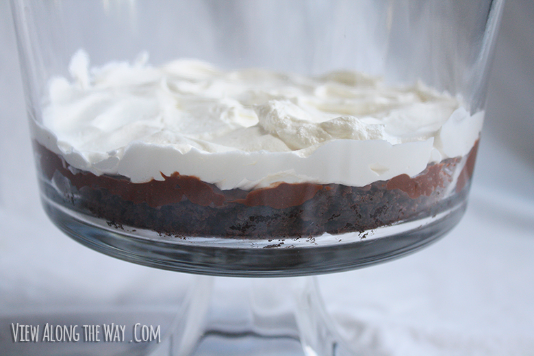 Layering cool whip/whipped topping on butterfinger dessert
