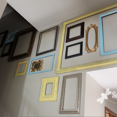Make a high-impact collage with frames - plus TONS of other inexpensive wall decor ideas!