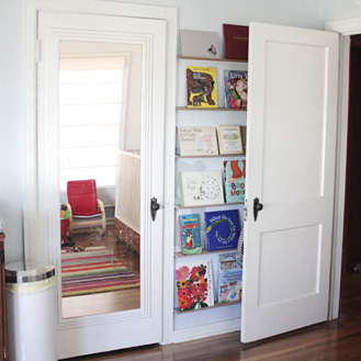 Make front-facing bookshelves for the lost space behind the door - and come check out the other creative storage and wall decor ideas at this link!