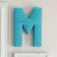 Easy DIY monogram - cover a cardboard letter with tulle! (And LOTS more creative DIY art ideas on this site!