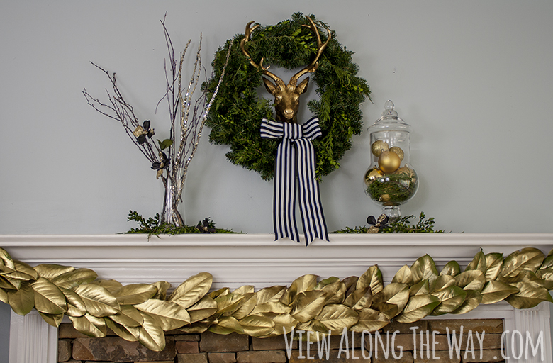 Christmas mantel: brass deer with greenery and a DIY golden magnolia garland!