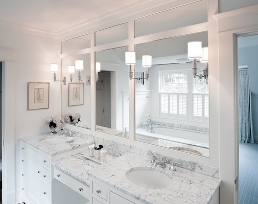 Beautiful dual bathroom vanities connected in the center